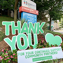 Thank-you signs to Community Partners in front of entrance to ER